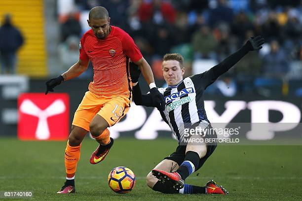 AS Roma's Brazilian defender Bruno Peres fights for the ball with Udinese's Argentinian midfielder Rodrigo Javier De Paul during the Italian Serie A...