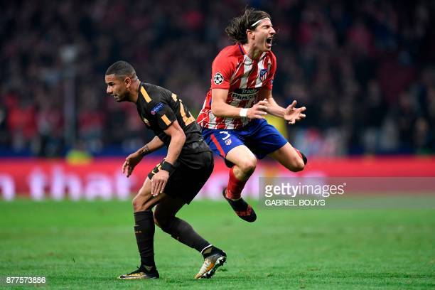 Roma's Brazilian defender Bruno Peres fouls Atletico Madrid's Brazilian defender Filipe Luis before being sent off during the UEFA Champions League...