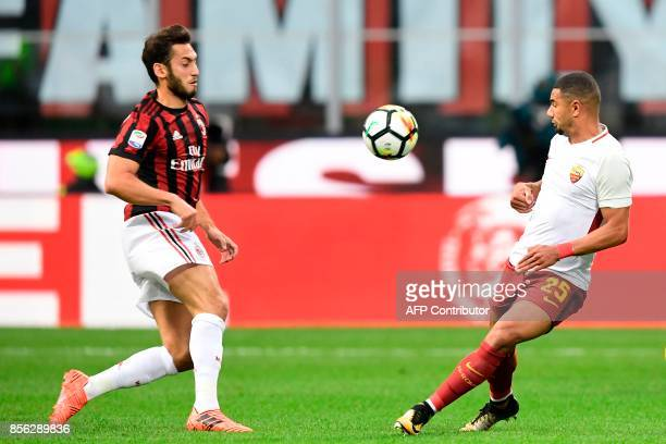 AS Roma's Brazilian defender Bruno Peres vies with AC Milan's German midfielder Hakan Calhanoglu during the Italian Serie A football match AC Milan...