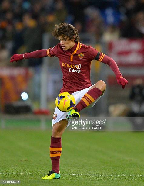 AS Roma's Brazilian defender Dodo controls the ball during the Italian Serie A football match AS Roma vs Cagliari on November 25 2013 at Rome's...