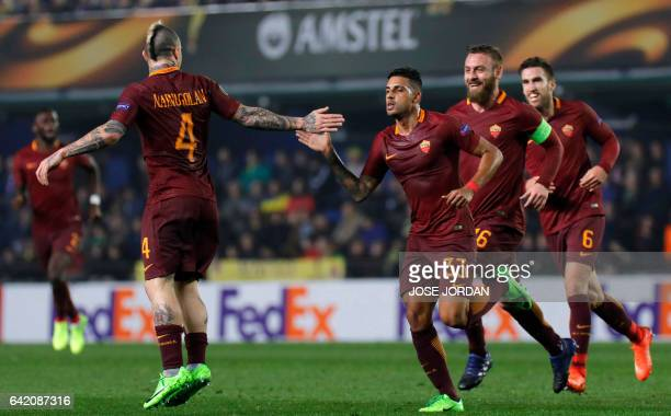 Roma's Brazilian defender Emerson Palmieri celebrates a goal with Roma's midfielder Daniele de Rossi Roma's Dutch midfielder Kevin Strootman and...