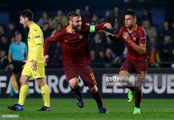 Roma's Brazilian defender Emerson Palmieri celebrates a goal with Roma's midfielder Daniele de Rossi during the Europa League round of 32 first leg...