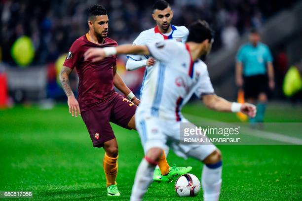 Romas Brazilian defender Emerson Palmieri vies for the ball during the Europa League round of 16 first leg football match between Lyon and AS Roma on...
