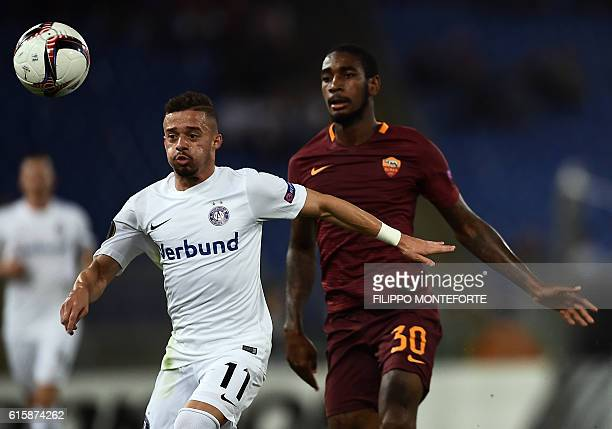 Roma's Brazilian defender Gerson vies with Wien's Brazilian midfielder Lucas Venuto during the Europa League Group E football match between Roma and...