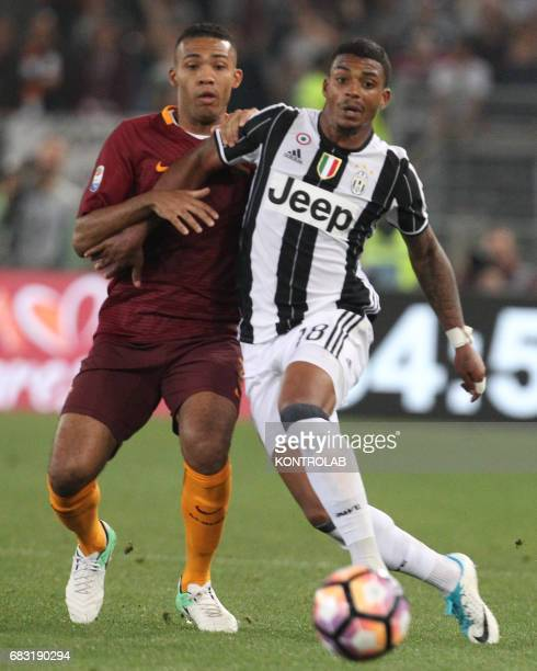 Roma's Brazilian defender Juan Jesus fights for the ball with Juventus' midfielder from Gabon Mario Lemina during the Italian Serie A football match...