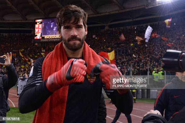 Roma's Brazilian goalkeeper Alisson celebrates at the end of the Italian Serie A football match AS Roma vs Lazio on November 18 2017 at the Olympic...