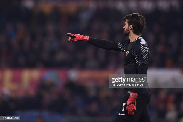 Roma's Brazilian goalkeeper Alisson gestures during the Italian Serie A football match AS Roma vs Lazio on November 18 2017 at the Olympic stadium in...
