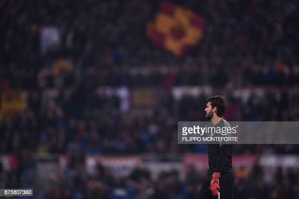 Roma's Brazilian goalkeeper Alisson looks on during the Italian Serie A football match AS Roma vs Lazio on November 18 2017 at the Olympic stadium in...