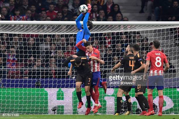 Roma's Brazilian goalkeeper Alisson makes a save during the UEFA Champions League group C football match between Atletico Madrid and AS Roma at the...