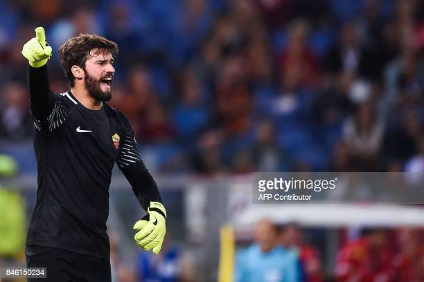 Roma's Brazilian goalkeeper Alisson Ramses Becker shouts instructions during the UEFA Champions League Group C football match between AS Roma and...