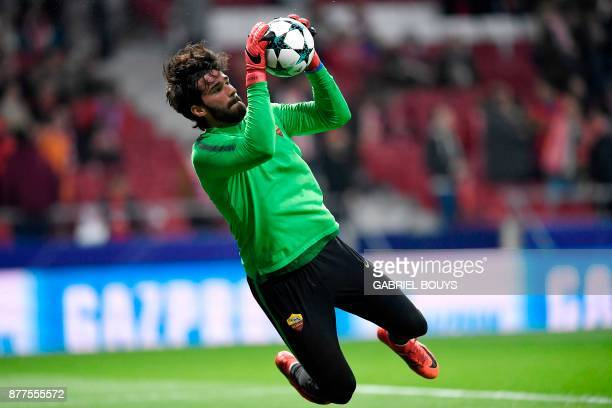 Roma's Brazilian goalkeeper Alisson warms up ahead of the UEFA Champions League group C football match between Atletico Madrid and AS Roma at the...