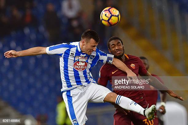 AS Roma's Brazilian midfielder Gerson Santos da Silva jumps to heads the ball as he vies with Pescara's Albanian midfielder Ledian Memushaj during...