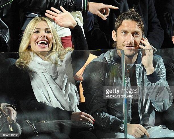 AS Roma's captain Francesco Totti and his wife Ilary Blasi watch the match between Spanish Rafael Nadal and Romanian Victor Hanescu during their ATP...