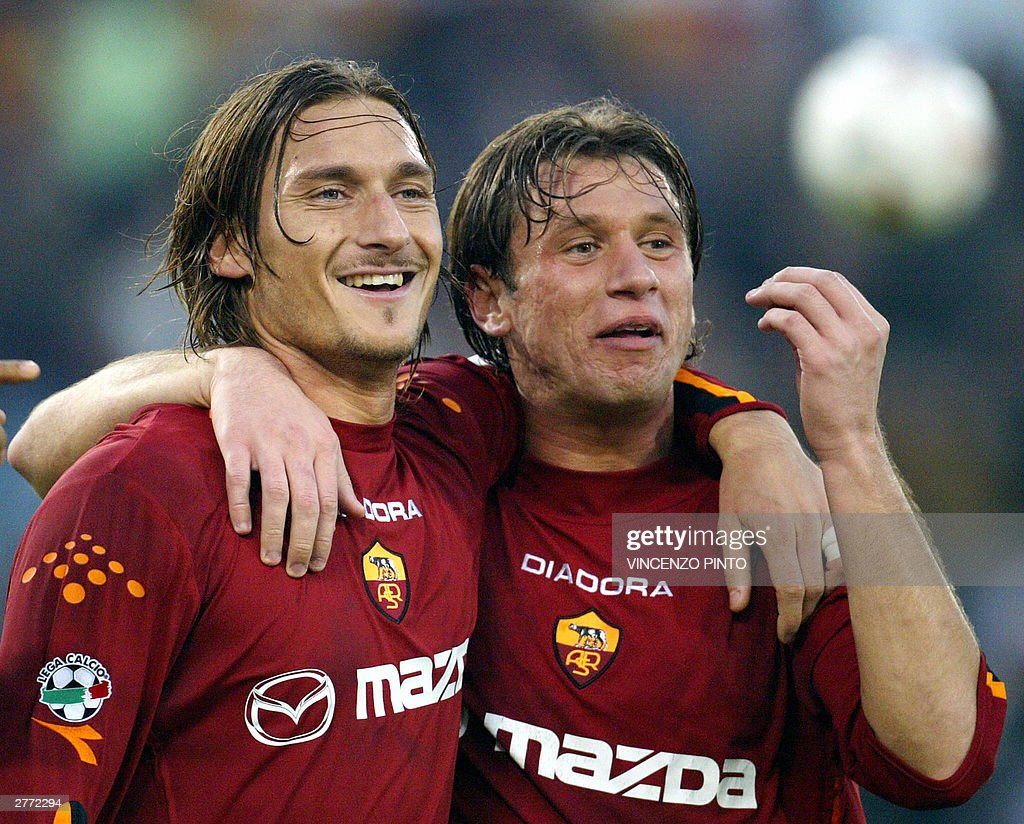 Roma's captain Francesco Totti celebrates together with his teammate Antonio Cassano after scoring against Lecce during their Serie A soccer match at...