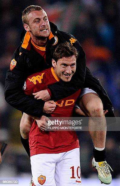 AS Roma's captain Francesco Totti celebrates with teammate Daniele De Rossi after their Serie A football matchagainst InterMilan in Rome's Olimpic...