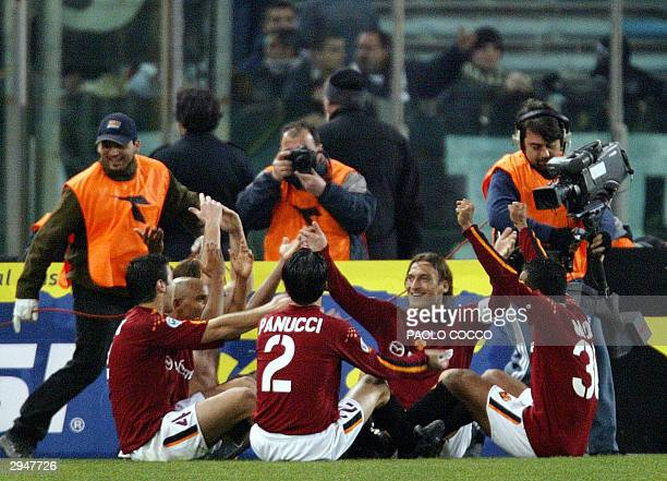 Roma's captain Francesco Totti celebrates with teammates at the end of AS Roma vs Juventus Serie A soccer match at the Olympic stadium in Rome 08...