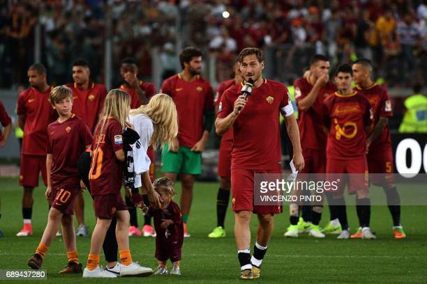 AS Roma's captain Francesco Totti delivers a speech next to his wife Ilary and his children during a ceremony following his last match with AS Roma...