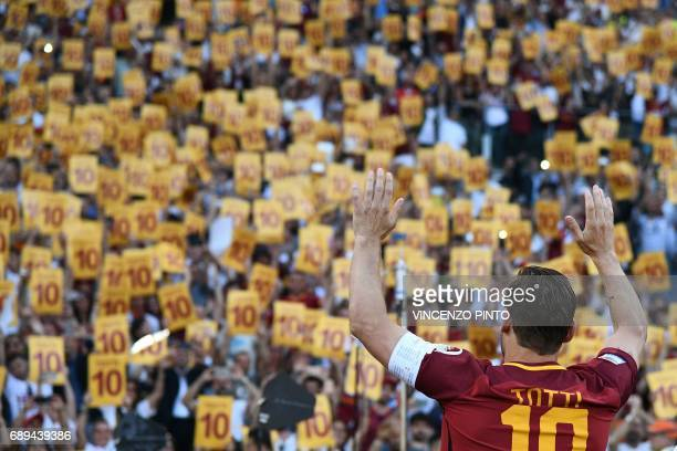 AS Roma's captain Francesco Totti greets fans during a ceremony following his last match with AS Roma after the Italian Serie A football match AS...