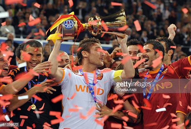 AS Roma's captain Francesco Totti holds up the trophy at the end of their Italian Cup soccer final match against Inter Milan at the Olympic stadium...