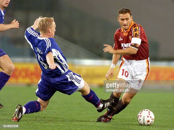 Roma's Captain Francesco Totti is tackled by Silkeborg's Michael Hansen during a first round second legs of UEFA Champion's Cup between AS Roma and...