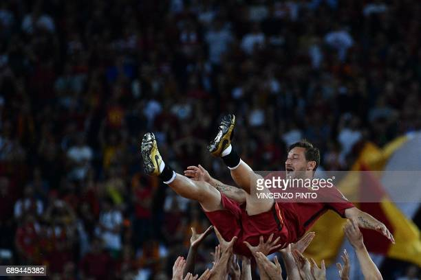 AS Roma's Captain Francesco Totti is tossed in the air by teammates during a ceremony following his last match with AS Roma after the Italian Serie A...