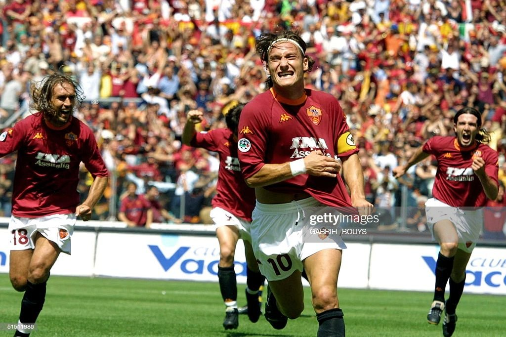 AS Roma's captain <a gi-track='captionPersonalityLinkClicked' href=/galleries/search?phrase=Francesco+Totti&family=editorial&specificpeople=208985 ng-click='$event.stopPropagation()'>Francesco Totti</a> jubilates after scoring the first goal against Parma during the last day of the First Italian League at Rome's Olympic Stadium, 17 June 2001. AFP PHOTO GABRIEL BOUYS