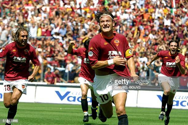 Roma's captain Francesco Totti jubilates after scoring the first goal against Parma during the last day of the First Italian League at Rome's Olympic...