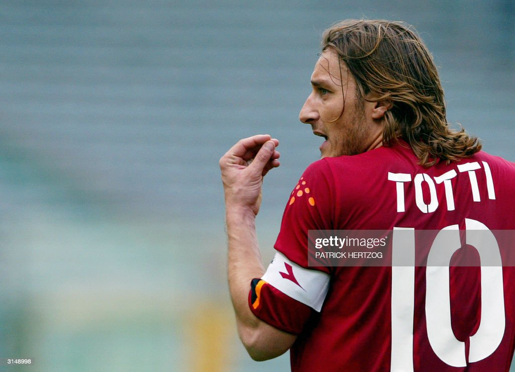 Roma's captain <a gi-track='captionPersonalityLinkClicked' href=/galleries/search?phrase=Francesco+Totti&family=editorial&specificpeople=208985 ng-click='$event.stopPropagation()'>Francesco Totti</a> reacts against Bologna, during their Serie A football match at Rome's Olympic stadium, 28 March 2004. Roma lost 1-2. AFP PHOTO/ Patrick HERTZOG