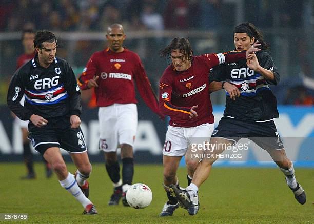 Roma's captain Francesco Totti vies with Sampdoria Genoa's midfielders Cristiano DONI and Stefano SACCHETTI as teammate French midfielder Olivier...