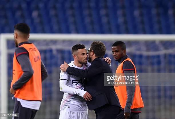 Roma's coach Eusebio Di Francesco hugs his son Bologna's forward Federico Di Francesco at the end of the Italian Serie A football match Roma vs...