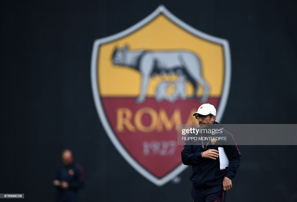 Roma's coach Eusebio Di Francesco looks on during a training session on the eve of the Champion's League football match Atletico Madrid vs Roma at Trigoria training ground at the outskirts of Rome on November 21, 2017. /