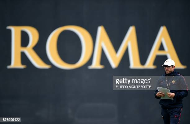 Roma's coach Eusebio Di Francesco looks on during a training session on the eve of the Champion's League football match Atletico Madrid vs Roma at...