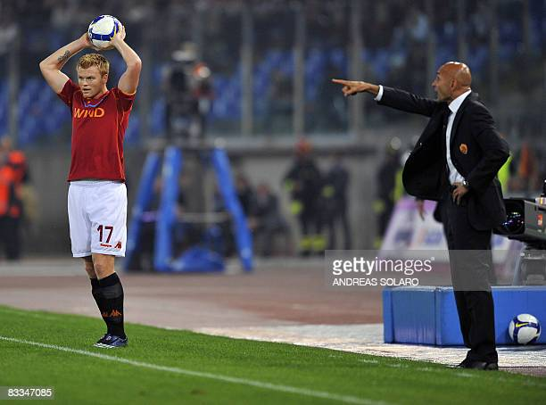AS Roma's coach Luciano Spalletti shouts to AS Roma's Norwegian defender John Arne Riise during their Italian Serie A football match against Inter...