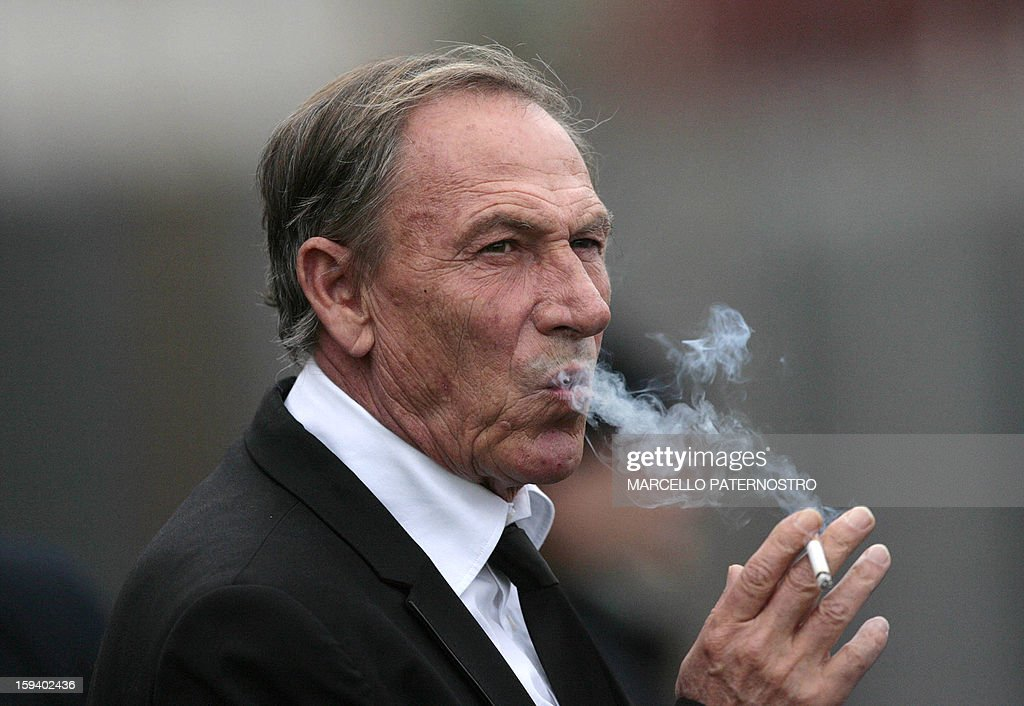 AS Roma's coach Zdenek Zeman smokes a cigarette before the start of an Italian Serie A football match between Catania and AS ROma at Massimino Stadium on January 13, 2013 in Catania. AFP PHOTO / Marcello PATERNOSTRO