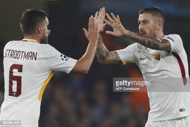 Roma's Croatian defender Aleksandar Kolarov celebrates after scoring with Roma's Dutch midfielder Kevin Strootman during a UEFA Champions league...