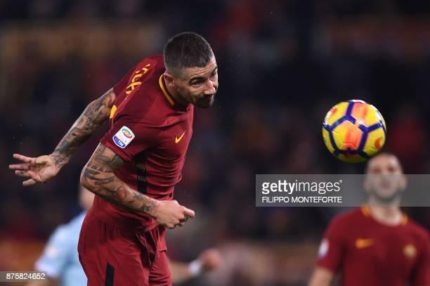 Roma's Croatian defender Aleksandar Kolarov heads the ball during the Italian Serie A football match AS Roma vs Lazio on November 18 2017 at the...