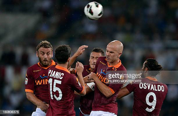AS Roma's Daniele De Rossi Goran Pjanic Francesco Totti Micheal Bradley and Osvaldo jump for the ball on August 26 2012 during an Italian Serie A...