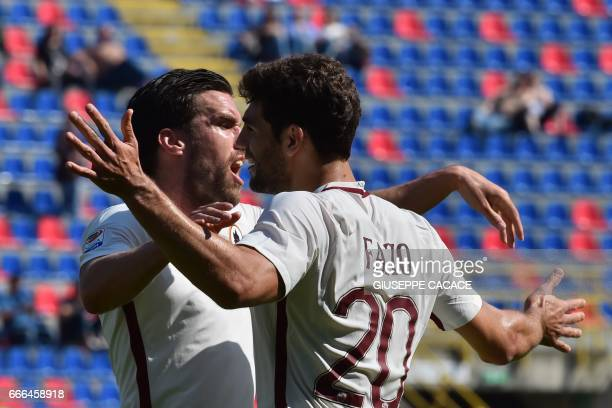 Roma's defender Federico Fazio from Argentina celebrates after scoring a goal with Roma's midfielder from Netherlands Kevin Strootman during the...