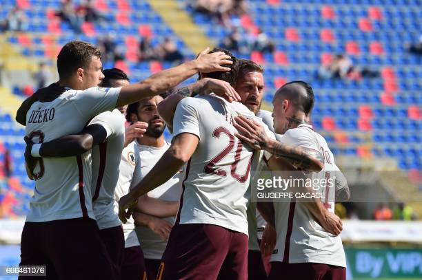 Roma's defender Federico Fazio from Argentina celebrates with teammates after scoring a goal with Roma's midfielder from Netherlands Kevin Strootman...