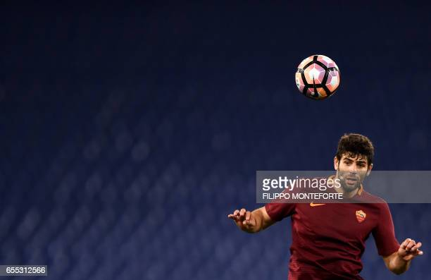 Roma's defender from Argentina Federico Fazio heads the ball during the italian Serie A football match Roma vs Sassuolo at the Olympic Stadium in...