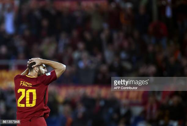 Roma's defender from Argentina Federico Fazio reacts during the Italian Serie A football match Roma vs Napoli at the Olympic Stadium in Rome on...