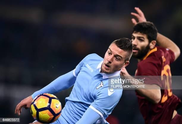 Roma's defender from Argentina Federico Fazio vies with Lazio midfielder form Croatia Sergej MilinkovicSavic during the Italian TIM Cup 1st leg...