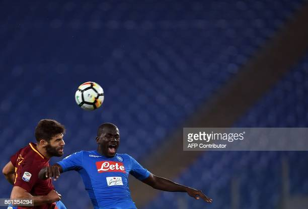 Roma's defender from Argentina Federico Fazio vies with Napoli's Senegalese defender Kalidou Koulibaly during the Italian Serie A football match Roma...