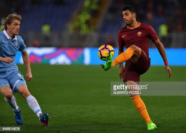 AS Roma's defender from Brazil Emerson Palmieri controls the ball in front of Lazio's defender from Serbia Dusan Basta during the Italian TIM Cup 1st...