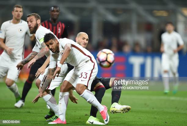 Roma's defender from Brazil Emerson vies with AC Milan's defender from Italy Gabriel Paletta during the Italian Serie A football match AC Milan vs AS...