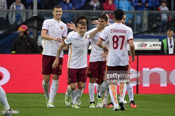 Roma's defender from France Luca Digne celebrates after scoring during the Italian Serie A football match Atalanta vs AS Roma on April 17 2016 at the...