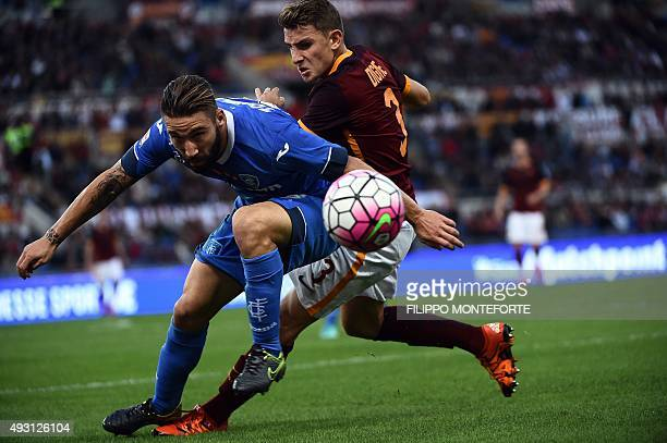 Roma's defender from France Lucas Digne vies with Empoli's defender from Italy Lorenzo Tonelli during the Italian Serie A football match AS Roma vs...