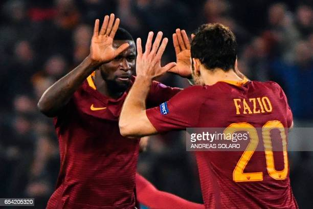 AS Roma's defender from Germany Antonio Rudiger celebrates with teammate Fazio after the autogoal of Lyion's midfielder from France Lucas Tousart...