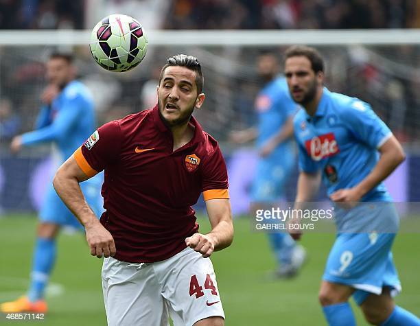 Roma's defender from Greece Konstantinos Manolas heads the ball during the Italian Serie A football match between AS Roma and Napoli on April 4 2015...