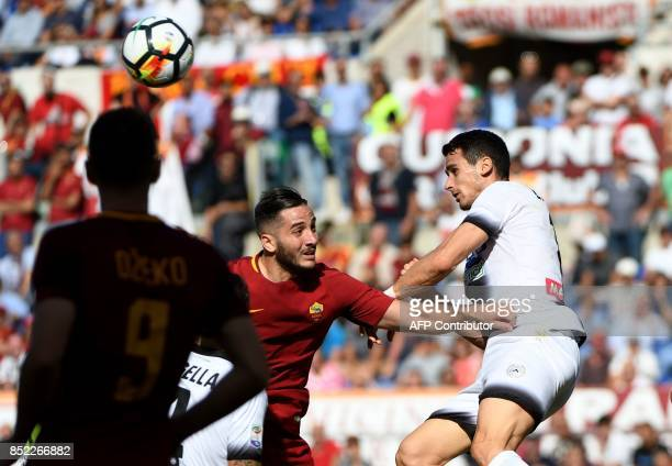 AS Roma's defender from Greece Kostas Manolas and Udinese forward Kevin Lasagna go for a header during the Italian Serie A football match AS Roma vs...